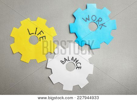 Papers in shape of gearwheel with words