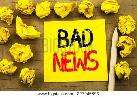 Bad News. Business Concept For Failure Media Newspaper Written On Sticky Note Paper On Vintage Backg