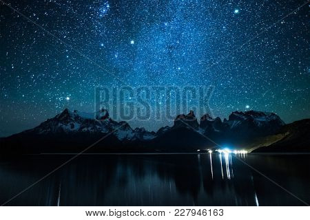 Torres del Paine National Park under starry sky reflected in the Lake of Pehoe, Chile