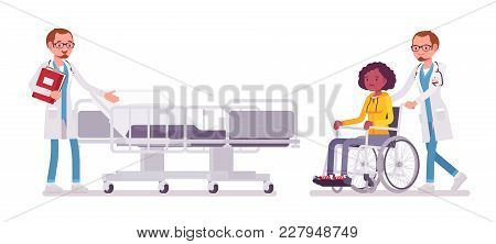 Male Doctor And Hospitalized Patient. Man In Hospital Uniform Admitting Wheelchair Woman In Clinic.