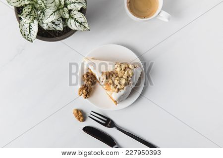 Top View Of Coffee Cup With Cake On Plate And Cutlery