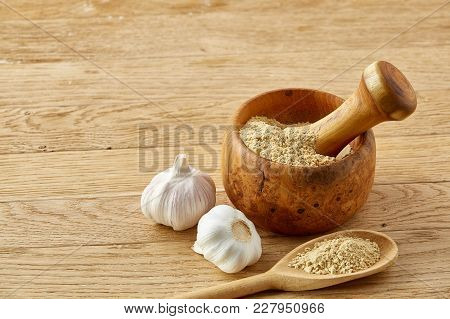 Beautiful Kitchen Still Life Wooden Mortar Full Of Grind Spicies And Pestle With Garlic And Flat Kit