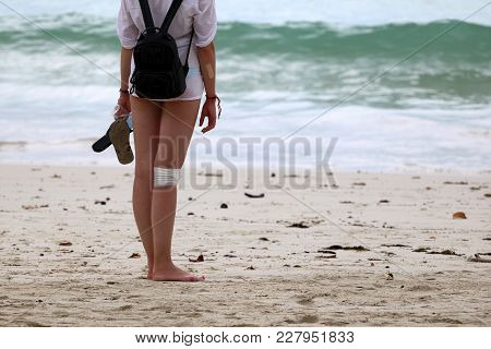 Injured Tourist Girl Relax On The Beach, Summertime In Thailand.
