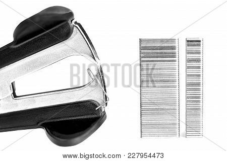 Staple Remover And Staples  On A White Background.