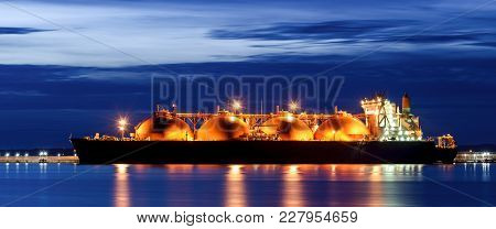 Lng Tanker At The Gas Terminal - Sunrise Over The Ship And Port