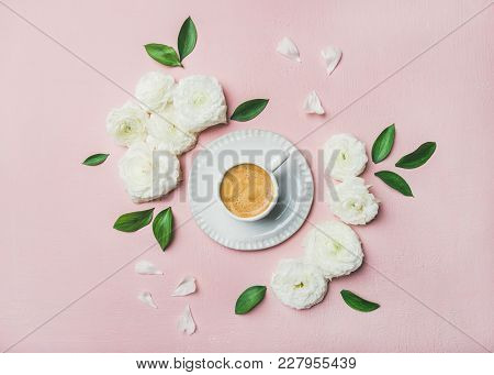 Spring Morning Concept. Flat-lay Of Cup Of Freshly Brewed Coffee Surrounded With White Ranunculus Fl
