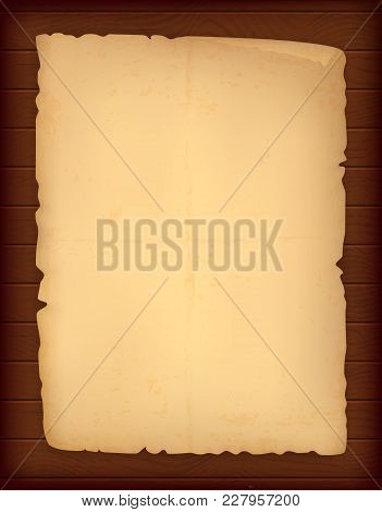 Aged Sheet Of Paper On A Wooden Table. Old Paper With Texture. Burnt Edges. Eps10 Vector