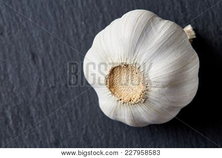 Close Up View Of Ripe Garlic Bulb Arranged On A Black Piece Of Board, Shallow Depth Of Field, Select