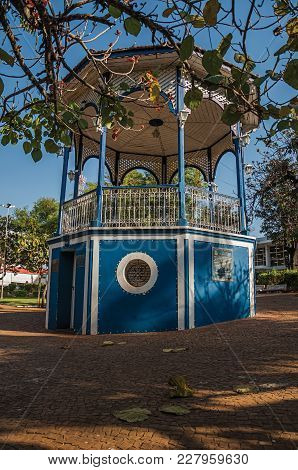 São Manuel, Southeast Brazil - September 08, 2017. Close-up Of Old Colorful Gazebo With Verdant Gard