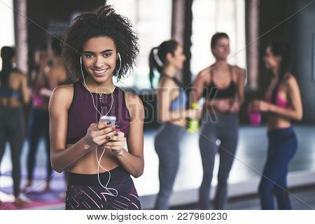 Attractive Sport Girls Are Having Rest After Doing Yoga Together. Healthy Lifestyle Concept. Young A