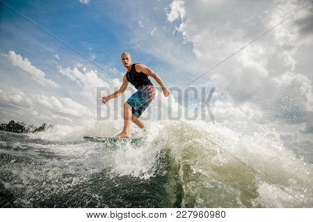 Young Spirited Wakeboarder In Black Swimsuit Going Wakesurfing Having Nice Extreme Summertime At The