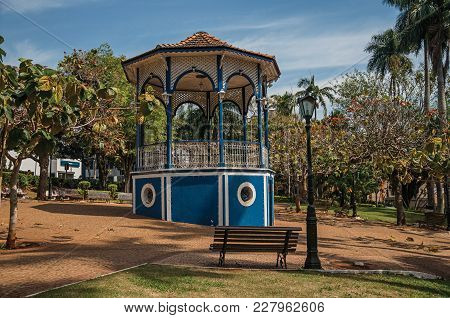 Sao Manuel, Southeast Brazil - September 09, 2017. Old Colorful Gazebo And Lighting Pole In A Verdan