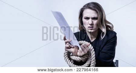 Work Dependent Woman Concept. Documents And Hands Tied Up With Rope As Symbol Of Hard Office Work An