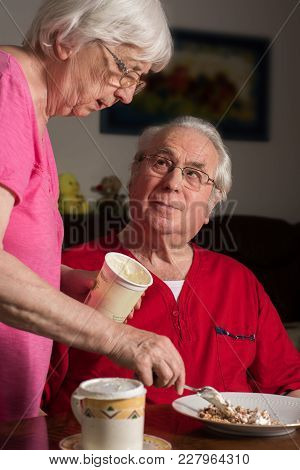 Ederly Couple At Home Are Preparing A Meal