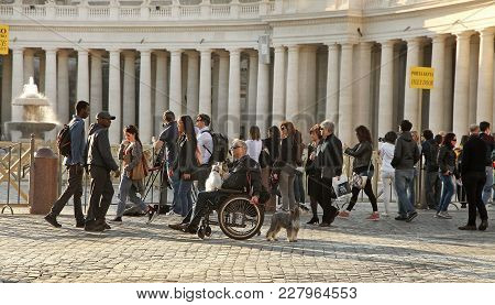 Rome, Italy - April 10, 2016: Tourists Are Visiting St. Peter's Basilica In The Vatican. St. Peter's