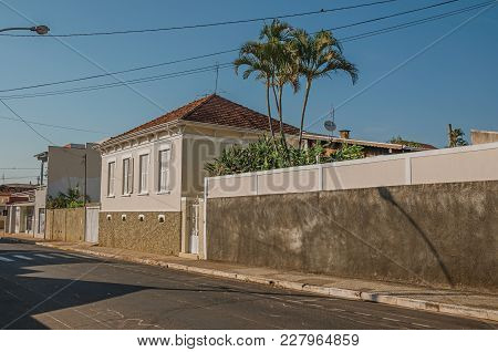 Sao Manuel, Southeast Brazil - October 14, 2017. Working-class Old House With Wall In An Empty Stree
