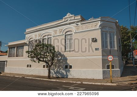 Sao Manuel, Southeast Brazil - October 14, 2017. Old Ornate Corner Townhouse In An Empty Street With