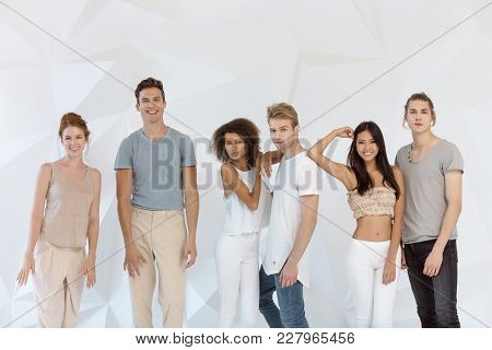 Group Of Young Multi-ethnic Beautiful People Wearing Casual Clothes Smiling And Having Fun Together
