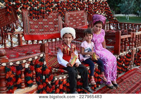 Ashgabat, Turkmenistan - September, 12, 2017. Unknown Turkmen Family With Children.  Boy In Traditio