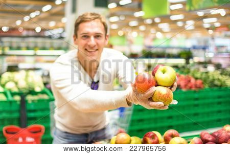 Young Single Man Showing Fruit And Vegetables At Shopping In Grocery Store Supermarket - Modern Heal