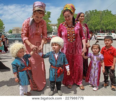 Kov-ata, Turkmenistan - April 30, 2017: Turkmen Women With Children Are Dressed In National Clothes.