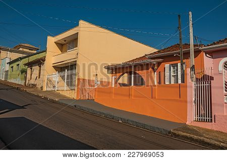 Sao Manuel, Southeast Brazil - October 14, 2017. Working-class Colored Houses And Fences In An Empty