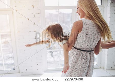 Mom And Daughter Having Fun At Home
