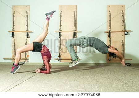 Oung Beautiful Fitness Couple Workout Extreme Acrobatic Exercise As Preparation For The Competition,
