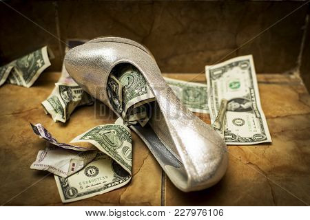 A White White Wedding Shoe Full Of Dollars And Currency. Ritual At Some Weddings-the Shoe Is Filled