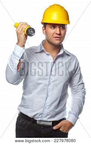 Portrait Of Male In Yellow Safety Helmet And Flashlight Over White Background.