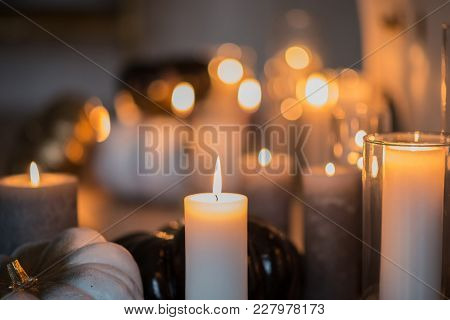 Romantic Atmosphere With Candles. Candles On The Table. Close-up.