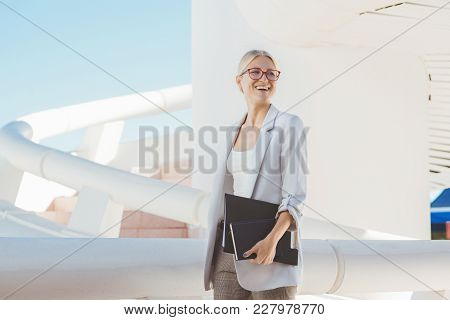 Young Blond Businesswoman Posing In A Modern Building.