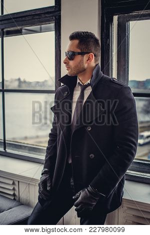 Moder Man In Sunglasses, Black Jacket And Tie.