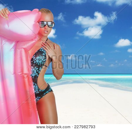 Emotional Blond Woman Posing With Pink Water Matress On White Background