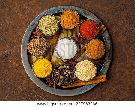 Mix Spices On Dark Brown Rusty Metal Plate - Coriander Seeds, Ground Red Pepper, Salt, Black Pepper,