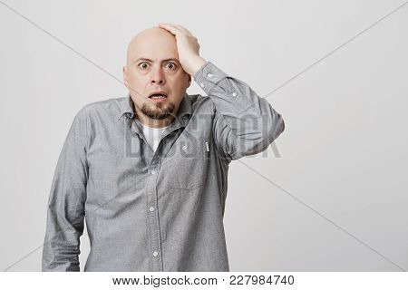 Bald Man With Beard, Wears Gay Shirt Being Shocked And Stunned With News He Heard, Keeping His Hand