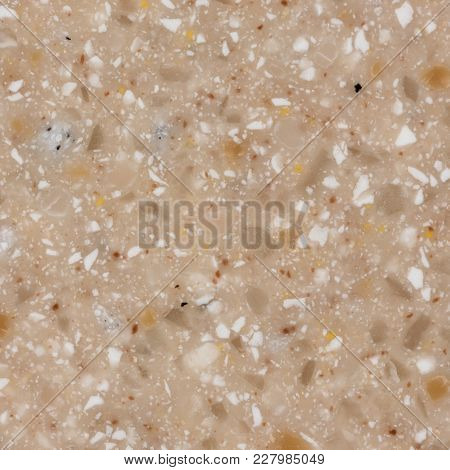 Close Up Of Background Beige Artificial Stone. High Resolution Photo.