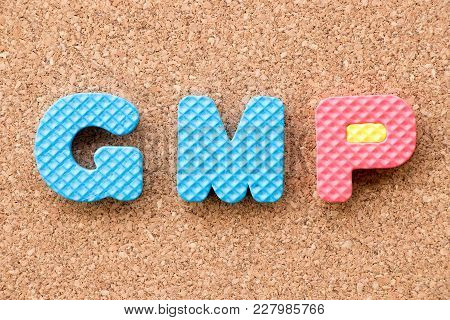 Color Toy Foam Alphabet In Word Gmp (abbreviation Of Good Manufacturing Practice) On Cork Board Back