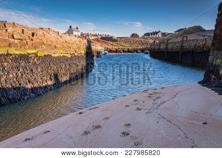 Low Tide At Seaton Sluice Harbour Entrance, Seaton Sluice Is A Village On The Northumberland Coast,
