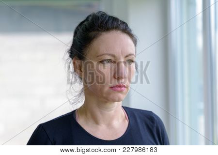 Thoughtful Woman Staring Out Of A Window