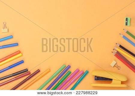 School Supplies On Blackboard. School Tools And Accessories Top View.