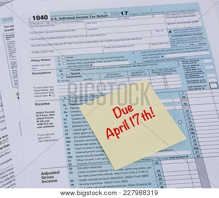 Irs 1040 Tax Form With Reminder For Taxes Due On April 17th