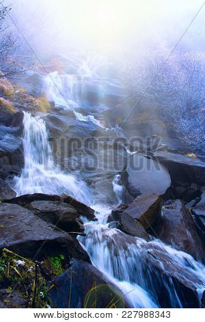 Beautiful Landscape With Waterfall And River Flowing In Mountains In Sunny Rays. Cascade Waterfall A