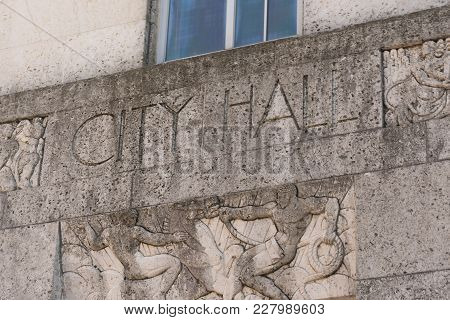City Hall Sign On The Front Facade Of Building