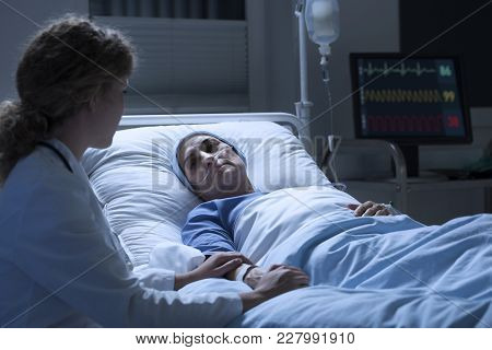 Nurse Supporting Woman With Leukemia