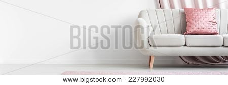 Pink Pillow On Beige Couch