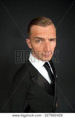 Businessman In Black Suit Wink Eye On Dark Background. Flirt, Intent, Interest, Secret, Sympathy, So