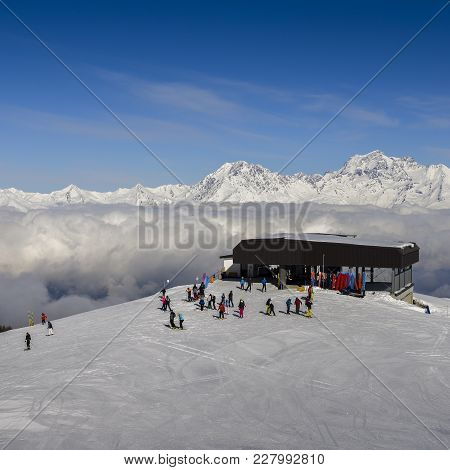 Chairlift At Italian Ski Area Of Pila On Freshly Groomed Snow Covered Alps Above Clouds - Winter Spo