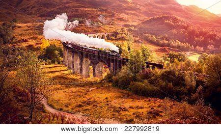 Historical Steam Train Is Crossing The Glenfinnan Viaduct