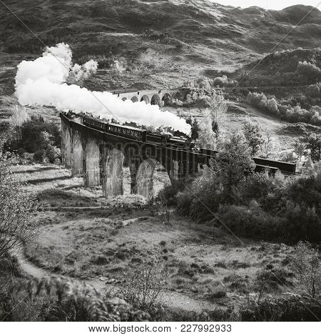 Historical Steam Train Is Crossing A Viaduct